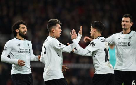 Liverpool's Roberto Firmino (2nd L) celebrates with the game's other goal-scorers, Mohamed Salah (L), Philippe Coutinho (2nd R) and Dejan Lovren (R) after scoring their fourth goal during the English Premier League football match against Bournemouth at the Vitality Stadium in Bournemouth, southern England on 17 December 2017. Picture: AFP
