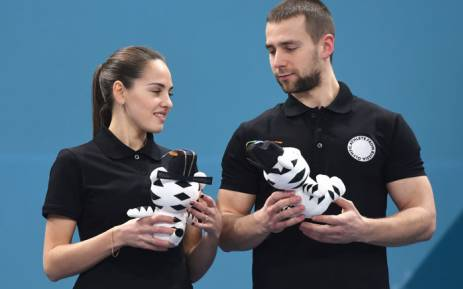 FILE: Russia's bronze medallists Anastasia Bryzgalova (left) and Alexander Krushelnitsky (right) celebrate on the podium during the curling mixed doubles venue ceremony at the Pyeongchang 2018 Winter Olympic Games. Picture: AFP.