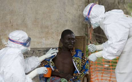 FILE: This picture released by the World Health Organisation at the Doctors without borders isolation ward of Kampungu shows MSF nurse Isabel Grovas (L) and Dr Hilde Declerck (R) taking care of a 43-year-old patient who had Ebola haemorrhagic fever. AFP.