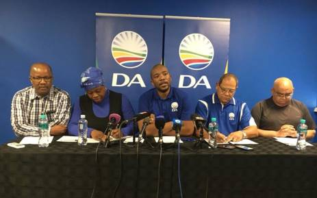 DA leaders Mmusi Maimane, centre, addressing media after the party's Federal Executive meeting in Bruma, east of Johannesburg. Picture: EWN.
