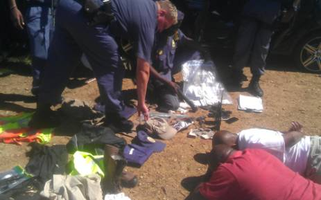 The Flying Squad and Tactical Response Team on 8 February, 2012 during the arrest of five gang members suspected to be behind a spate of truck hijackings and vehicles posing as police officers. Picture: SAPS.