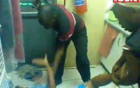 A screengrab from an exclusive Daily Sun video which shows a woman being beaten with a belt and rubber hammer.