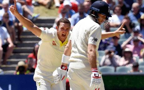 Australia's paceman Josh Hazlewood (L) celebrates dismissing England batsman Chris Woakes (R) on the final day of the second Ashes cricket Test match in Adelaide in 6 December, 2017. Picture: AFP.