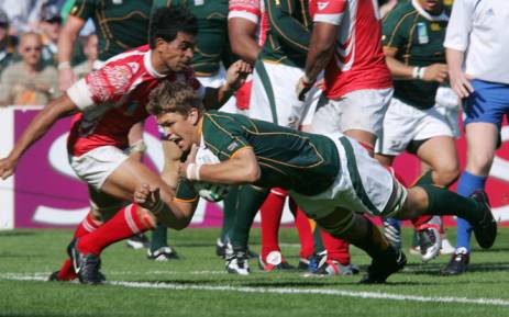 FILE: Springbok flanker Juan Smith scores a try in the match against Tonga at the 2007 Rugby World. Picture: AFP