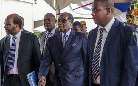 FILE: Zimbabwe's former President Robert Mugabe (centre) arrives for a graduation ceremony at the Zimbabwe Open University in Harare on 17 November 2017. Picture: AFP