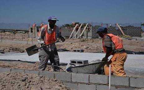 Builders work on a housing project in Cape Town. Picture: EWN.