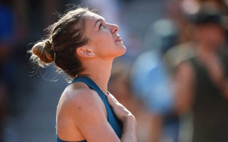 Romania's Simona Halep celebrates after victory over Germany's Andrea Petkovic at the end of their women's singles third round match on day seven of The Roland Garros 2018 French Open tennis tournament in Paris on 2 June 2018. Picture: AFP.