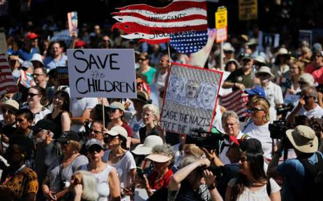 FILE: Demonstrators march against the separation of immigrant families on 30 June 2018 in New York. Picture: AFP.