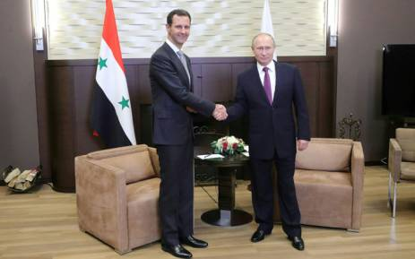 Russia's President Vladimir Putin (R) shakes hands with his Syrian counterpart Bashar al-Assad during a meeting in Sochi on November 20, 2017. Picture: AFP