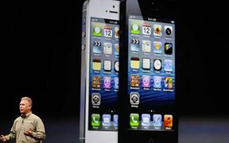 Apple Inc senior Vice President Phil Schiller reveals the new iPhone 5 on 12 September, 2012. Picture: Reuters.