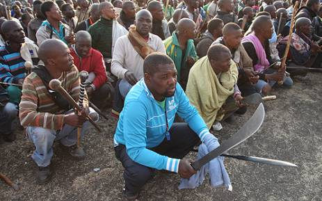 Protesters await instruction from their leaders, at Lonmin's Marikana mine. Picture: Taurai Maduna/EWN.