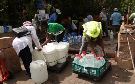 Cape Town residents collect water from the Newlands mountain spring. Picture: Bertram Malgas/EWN