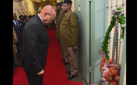 President Jacob Zuma lays a wreath at the prison cell at Kgosi Mapuru II Correctional Service Centre where liberation struggle hero Steve Bantu Biko died on 12 September 1977. Picture: GCIS.