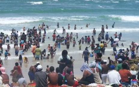 Bathers hit the surf at Mnandi Beach.