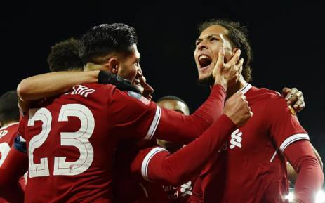 Liverpool's Virgil van Dijk celebrates with teammates after scoring a goal against city rivals Everton. Picture: @LFC/Twitter.