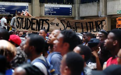 FILE: Wits students hold up a banner inside Senate House on 19 October 2015 during protests over proposed fee increases at the institution for the 2016 year. Picture: Reinart Toerien/EWN.