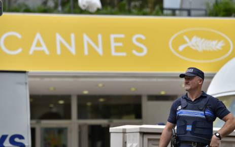 A French police officer stands guard in front of the Festival Palace in Cannes on 10 May 2016 on the eve of the beginning of the 69th Cannes film festival. Picture: Loic Venance/AFP.
