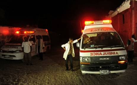 Two ambulances stand on the scene of a bomb attack on 21 January 21 2016 at Lido Beach, in Mogadishu. Picture: Mohamed Abdiwahab/AFP.