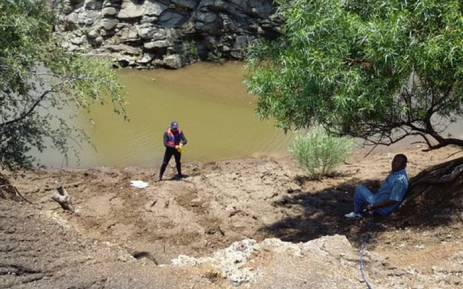 Police divers searched for bodies of two men who were tied up, assaulted and thrown in dam at Marikana. Picture: @SAPoliceService.
