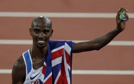 Britain's Mo Farah celebrates after winning the final of the men's 10,000m athletics event at the 2017 IAAF World Championships at the London Stadium in London on 4 August, 2017. Picture: AFP