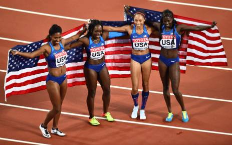 US athletes Aaliyah Brown, Morolake Akinosun, Allyson Felix and Tori Bowie pose with their flag as they celebrate winning the final of the women's 4x100m relay athletics event at the 2017 IAAF World Championships at the London Stadium in London on 12 August 2017. Picture: AFP.