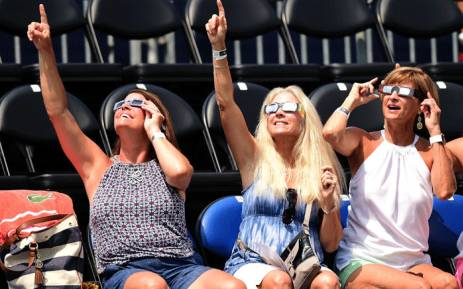 Americans watch the solar eclipse during the third day of the Winston-Salem Open at Wake Forest University on 21 August 2017 in Winston Salem, North Carolina. Picture: AFP