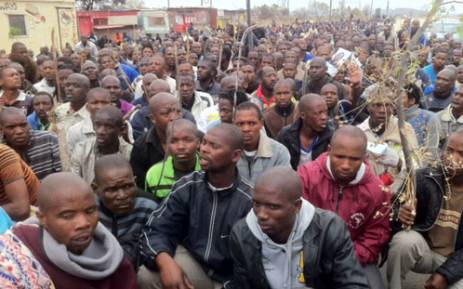Lonmin workers gather, to march for better salaries. Picture: Taurai Maduna/EWN.
