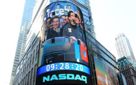 Facebook co-founder Mark Zukerberg is seen on a screen getting ready to ring the NASDAQ stock exchange opening bell in Times Square in New York, May 18, 2012. Picture: AFP.