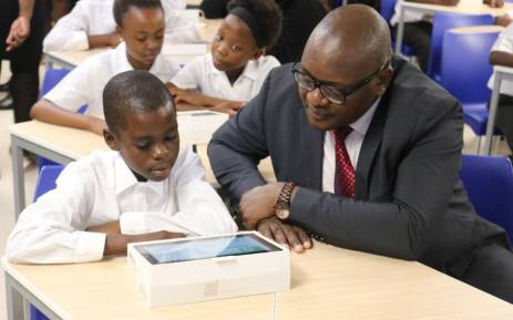 Gauteng Premier David Makhura seen with one of the pupils at the newly built Nomzamo Madikizela Mandela Primary School in Soweto. Picture: @GautengProvince.