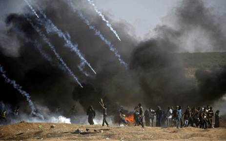 Tear gas is fired at protestors during clashes with Israeli forces near the border between the Gaza Strip and Israel, east of Gaza City on 14 May 2018, following the controversial move to Jerusalem of the United States embassy. Picture: AFP