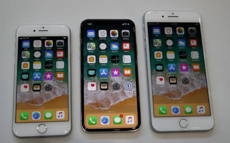 (L-R) The new iPhone 8, iPhone X and iPhone 8S are displayed during an Apple special event at the Steve Jobs Theatre on the Apple Park campus on September 12, 2017 in Cupertino, California. Picture: AFP