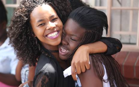 Two Mfuleni Secondary School matriculants celebrate passing their final exams in Cape Town on 6 January 2016. Picture: Reinart Toerien/EWN.