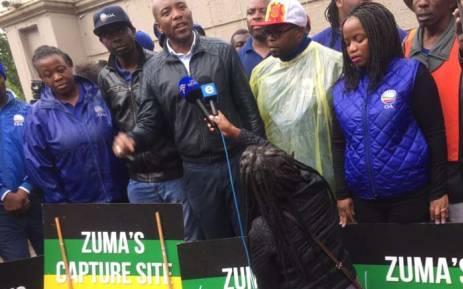 DA places ''capture site'' signs outside the Gupta compound
