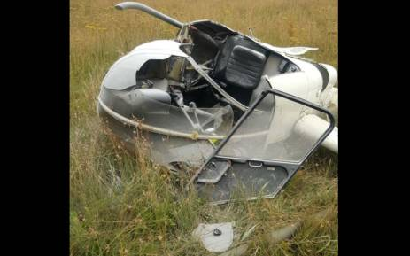A helicopter crash near Swart Koppies Road in Brackendown, south of Johannesburg. Picture: @ER24EMS/Twitter.