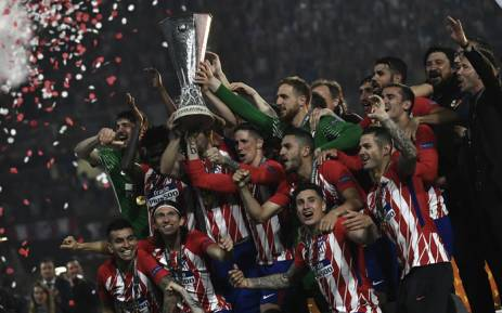 Atletico Madrid players celebrate their victory in the final over Olympique de Marseille on 16 May 2018. Picture: AFP