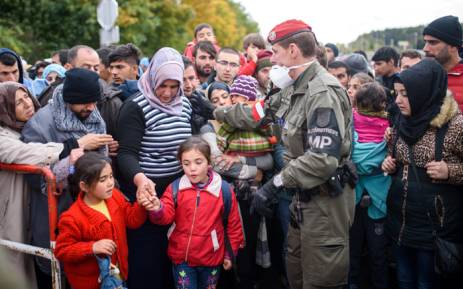 FILE: Migrants and refugees cross the Slovenian-Austrian border in Sentilj onto Spielfeld on 20 October, 2015. Picture: AFP.