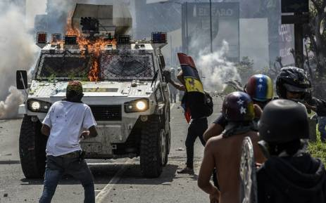Image result for Venezuela protests: Young demonstrators fling faeces at soldiers as unrest claims more lives