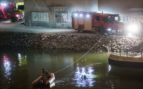 Divers and rescue service personnel search for the victims of the deadly car crash involving four members of the band Viola Beach and their manager, in the canal under the E4 highway bridge in Sodertalje, Sweden, 13 February, 2016.