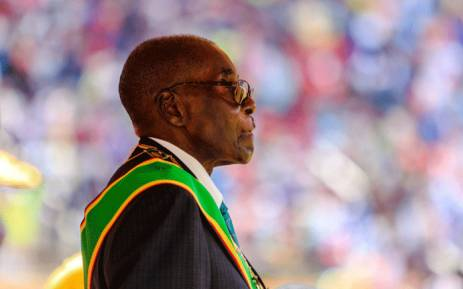 This file photo taken on 18 April 2017 shows Zimbabwe's former president, Robert Mugabe, reviewing the guard of honour during the country's 37th Independence Day celebrations at the National Sports Stadium in Harare. Picture: AFP
