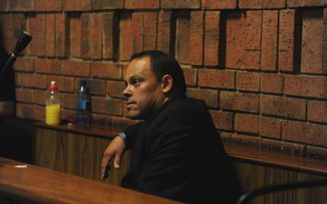 The former investigating officer in Oscar Pistorius' criminal case, Hilton Botha, is seen in the Pretoria Magistrate's Court on 20 February 2013. Picture: Barry Bateman/EWN