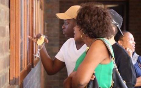 Matrics looking at their results at St John's College. Picture: Sethembiso Zulu/EWN.