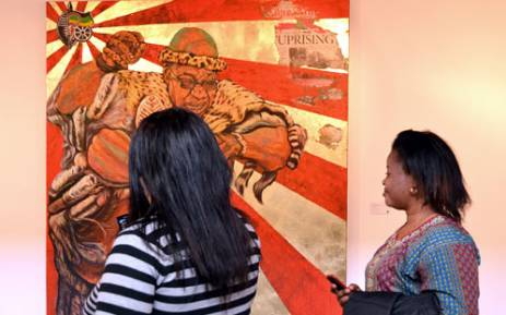 Gallery visitors take cellphone pictures of the painting entitled Umshini Wam by Ayanda Mabulu on 28 August 2012. Picture: Aletta Gardner/EWN.