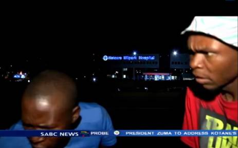 A screengrab shows two men that mugged the SABC news crew while preparing to go live on air outside Milpark Hospital on 10 March 2015.