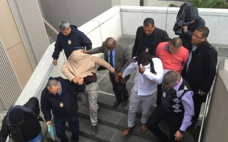 Cts siu clamps down on illegal traffic licencing operation three city of cape town traffic officials are marched out of the civic centre after they altavistaventures Images