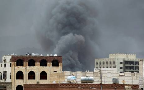 Smoke billows following an air-strike by the Saudi-led coalition on the headquarters of the Special Security Forces, formerly known as the Central Security, on May 27, 2015, in the Yemeni capital Sanaa. Picture: AFP.