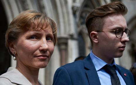 Anatoly Litvinenko (R), son of former Russian spy Alexander Litvinenko, listens as his mother Marina speaks to the media outside the Royal Courts of Justice in central London on July 31, 2015, following the conclusion of the Litvinenko inquiry. Picture: AFP.