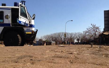Residents of Protea South in Soweto watch on as police continue to closely monitor their community following violent protests on 10 August, 2013. Picture: Lesego Ngobeni/EWN