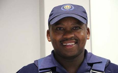 Nelson Mandela Bay Metro Police officer Luyolo Nojulumba who saved a toddler at the Joe Slovo informal settlement on Thursday 12 April 2018. Picture: Twitter/@AtholT
