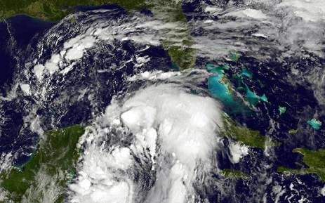NOAA's GOES East satellite provided a visible image of Nate that showed the center back over water in the northwestern Caribbean Sea. Picture:  NASA/NOAA GOES Project