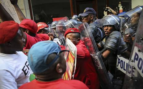 EFF supporters clash with police outside Parliament in Cape Town ahead of President Jacob Zuma's 2016 State of the Nation address. Picture: Thomas Holder/EWN.